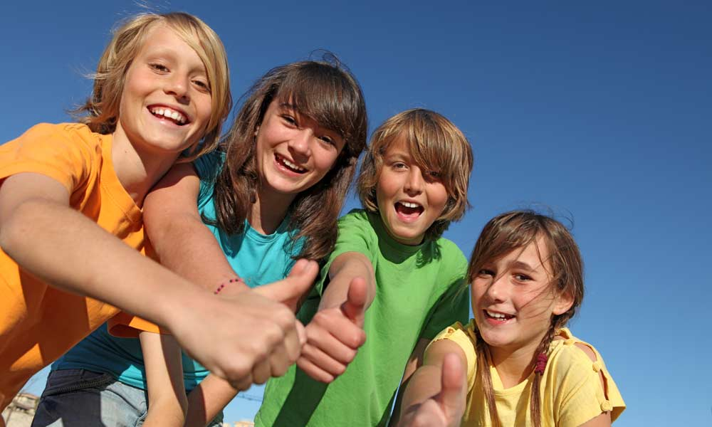 Depositphotos 6469765 Stock Photo Smiling Group Of Kids Or 1000x600k